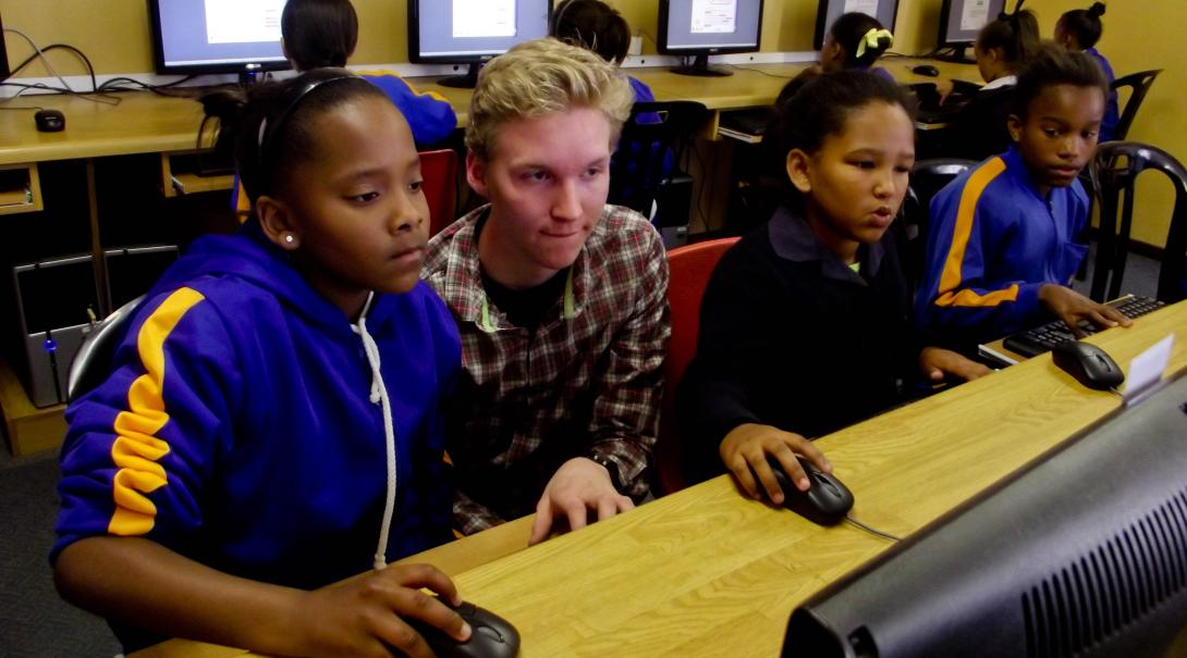 A Projects Abroad volunteer runs an IT class in Ghana during his IT teaching internship.